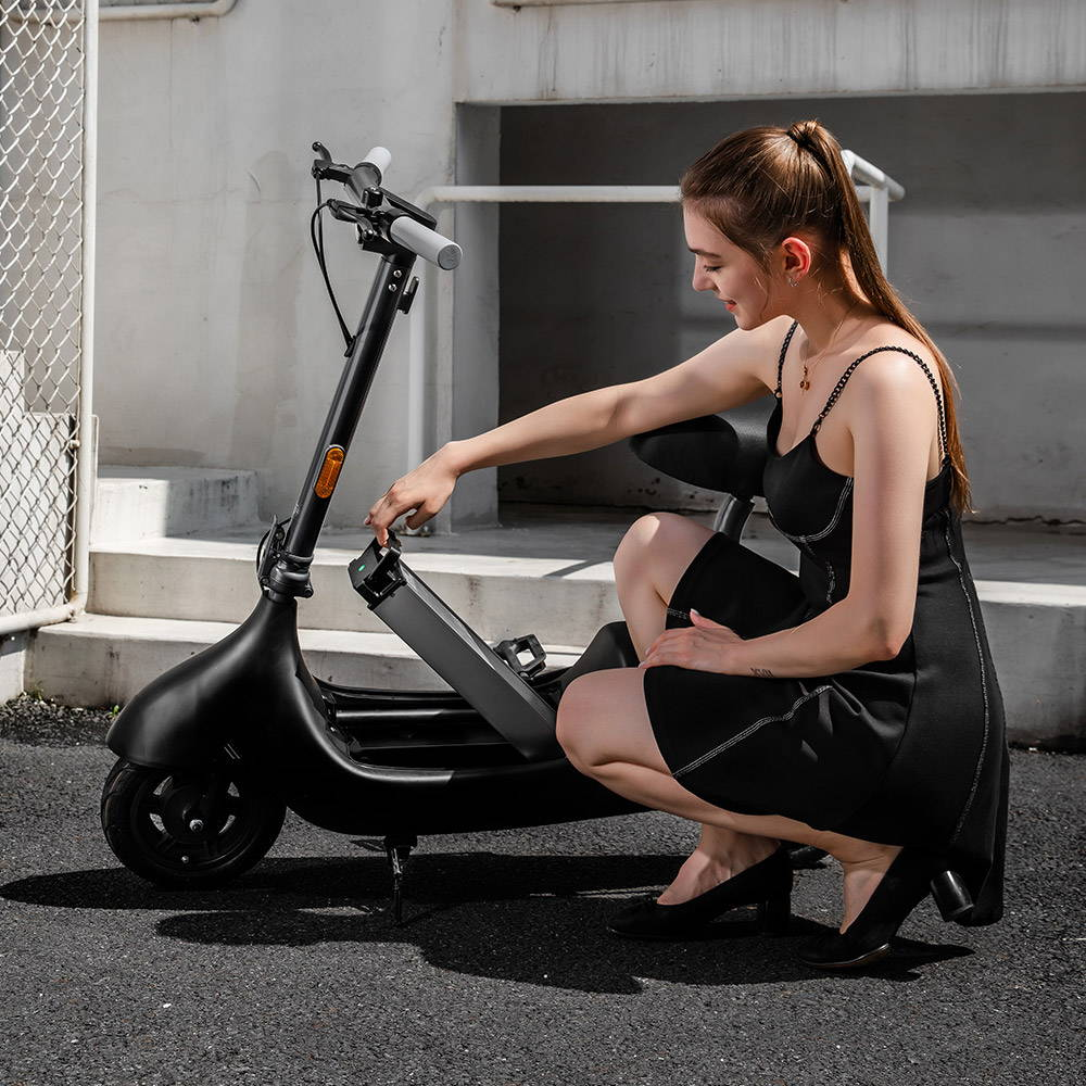 okai ea10 black electric scooter removable swappable battery girl