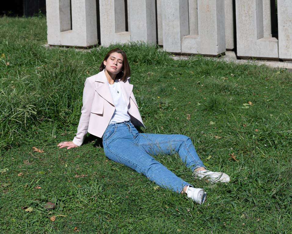 IXORA apparel pink blazer model laying in grass