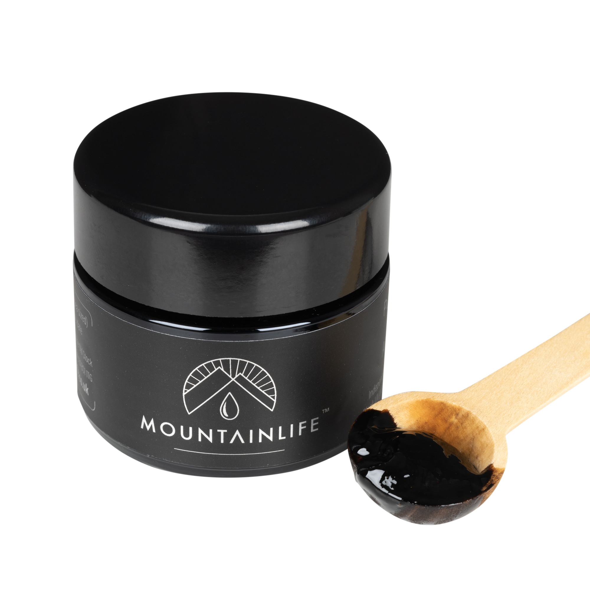 mountainlife shilajit resin in 30g jar with wooden scooping spoon