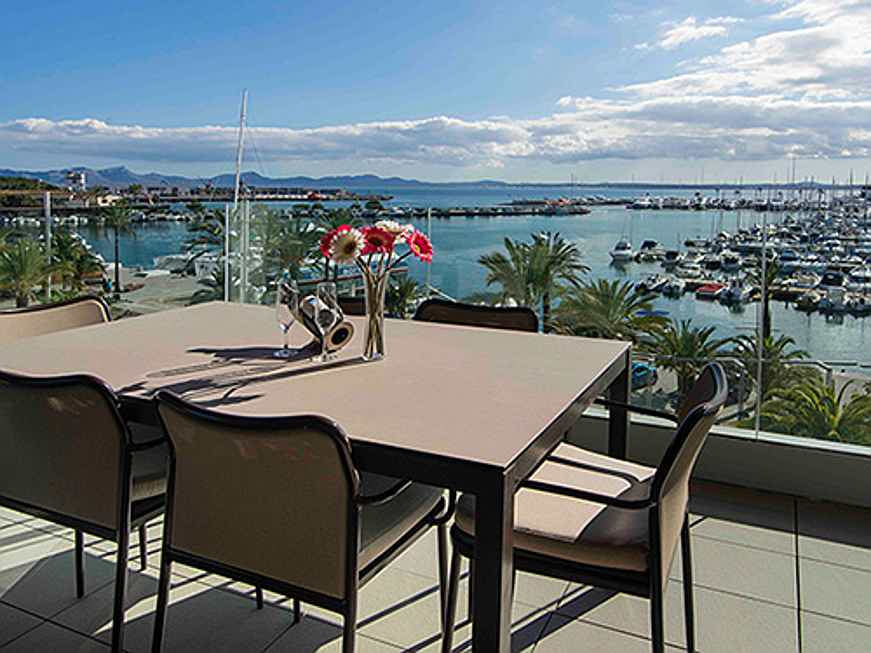 Mriehel - This exclusive apartment is on the market for 1.2 million euros and affords superb views of the marina in Alcúdia. (Image source: Engel & Völkers Majorca Puerto Alcúdia
